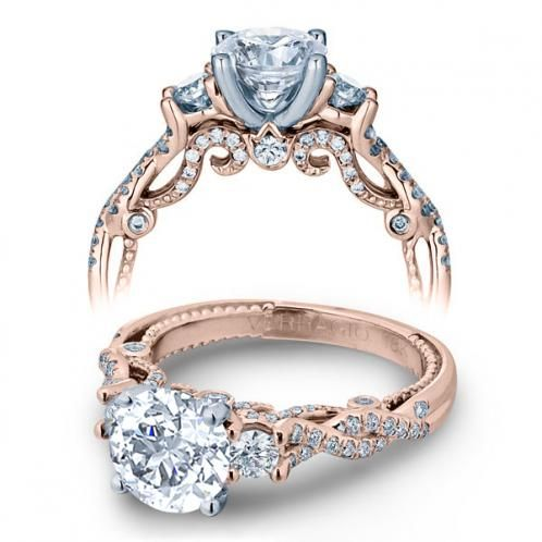 Prepare your eyes for the luscious visual feast in this out of this world diamond engagement ring. A real head turner, this spotless piece features a very remarkable Brilliant-cut diamond as the focus. Dazzling Brilliant Round cut diamonds are pave set around it with Rose Gold Diamond Accents.With Diamond Mansions Rings, You can Walk down the aisle in style!