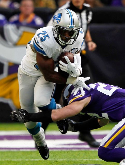 Lions vs. Vikings:  22-16, Lions  -  November 6, 2016  -     Detroit Lions running back Theo Riddick (25) is tackled by Minnesota Vikings free safety Harrison Smith during the first half of an NFL football game Sunday, Nov. 6, 2016, in Minneapolis.