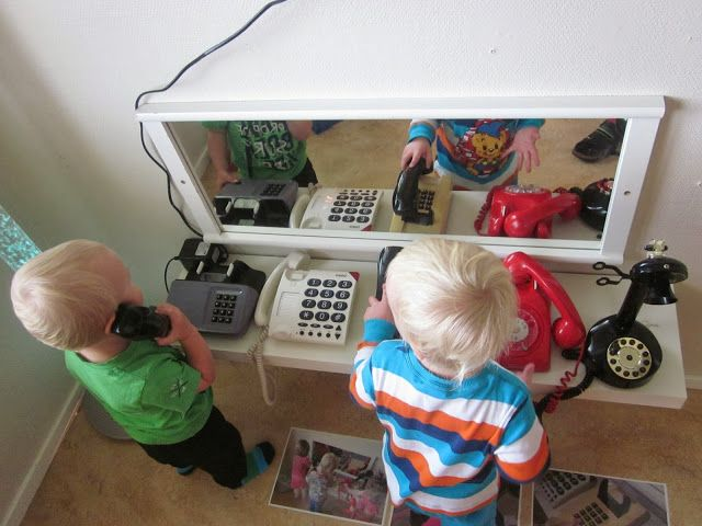 A phone  center - adding the mirror is a great idea!  Perfect for language development!