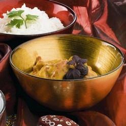 Kip tandoori: Indiaas gerecht met kip in een saus met o.a. yoghurt en div. groenten.