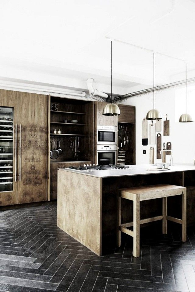 Industrial kitchen with solid smoked-oak cabinets, a marble bench top, hand-carved brass knobs, and brass pendant lights