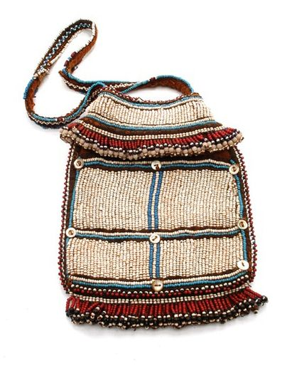 Africa | Beaded bag from the Mfengu people of South Africa  | 19th century | Cotton, glass beads and shell || (Note:  Original description from source; beaded bag from the Zulu or Ndebele people)