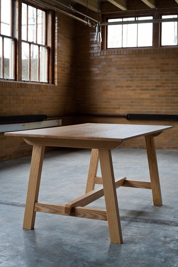 Craftsman Solid Wood Dining Table in Ash    From Hedge House - this is a front runner for my dining room table right now. handcrafted by an amish wood worker with over 20 years experience. It's made from solid ash, and has a matte finish. The legs remove for shipping.