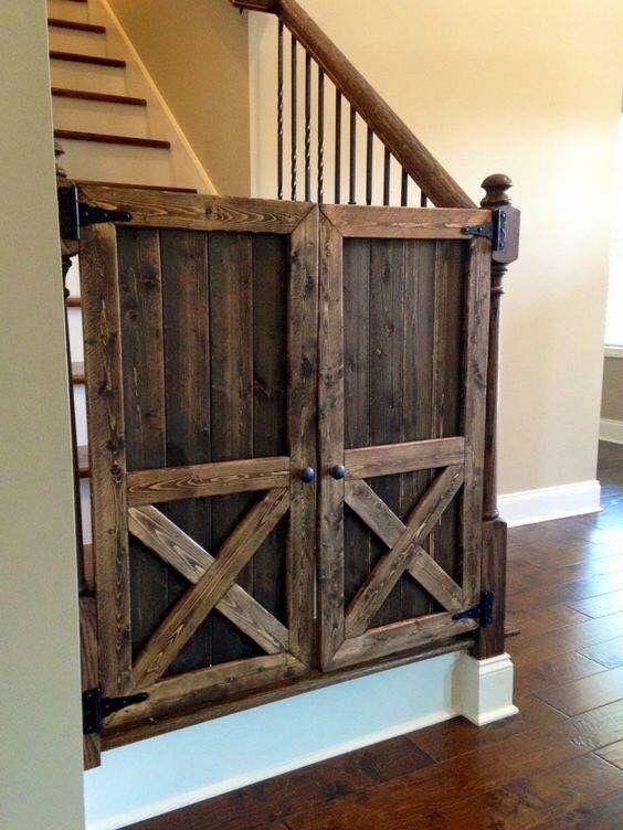 Rustic styled DOORS on STAIRS to keep small children or pets off.