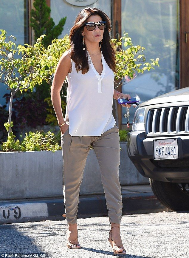 Height of style: Eva added a boost to her 5ft 2in frame with strappy nude heels and shielded her eyes with large sunglasses