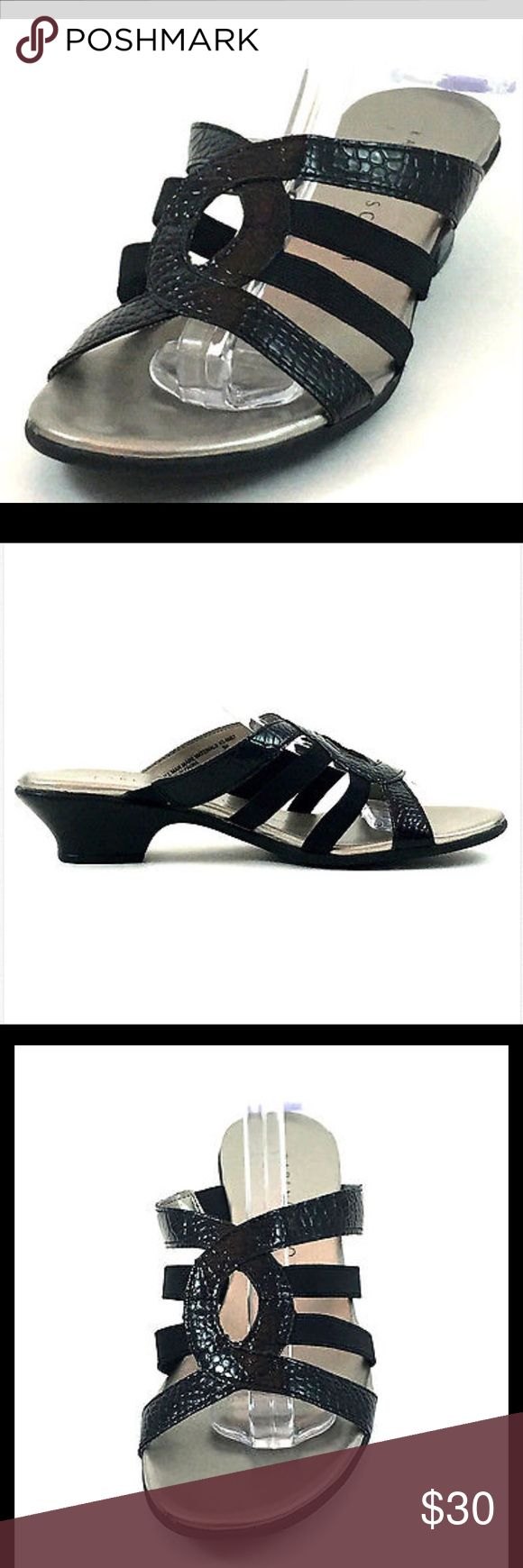 Karen Scott Women's Black Leather Slides New with defects. Top and bottom straps and center detail are the snake skin print embossed areas.  The two middle straps on either side are black elastic. Man made silver foot bed does provide some cushioning. Black rubber sole. Sandals were department store display shoes. They are in very good overall condition. There is minimal wear to the soles from being tried on in the store. The leather uppers are intact and don't have any damage. (Item# KS-01)…