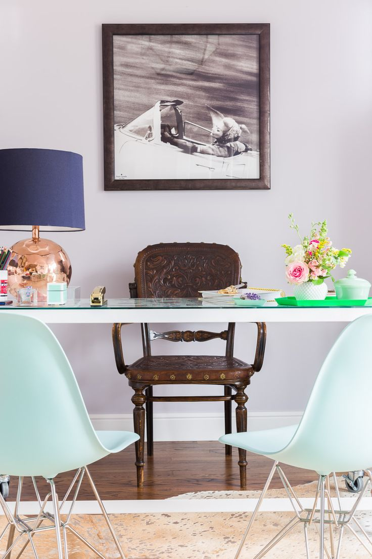 Teal Guest Chairs And Wooden Engraved Chair For An Office Space