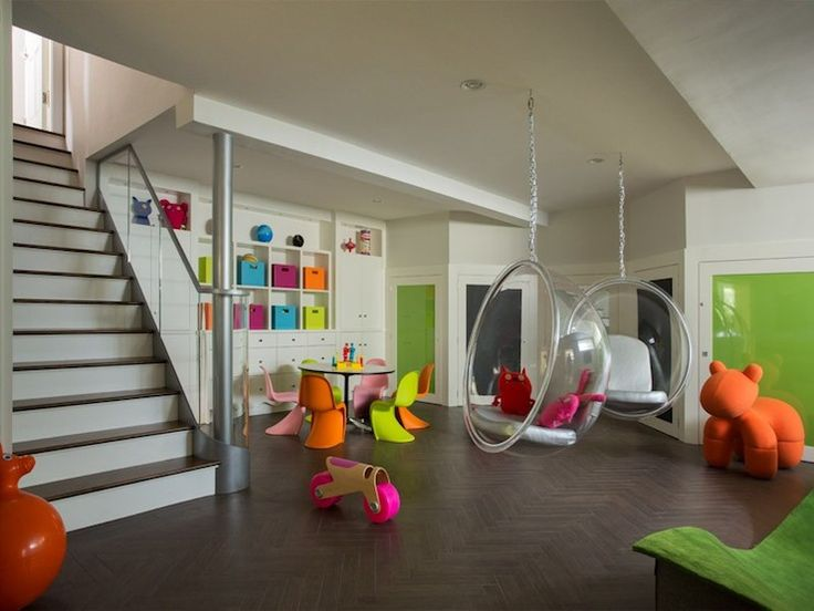 Amazing Basement Playroom With Eero Aarnio Bubble Hanging Chairs Suspended  Over Herringbone Floor Next To Round
