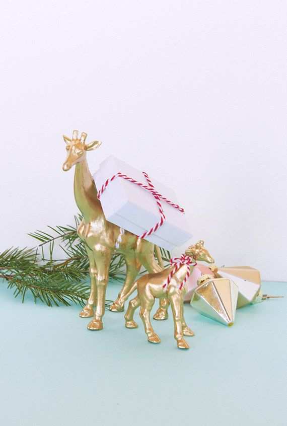 All you need for this cute concept is an animal figurine, some baker's twine or ribbon and a small box. It's a great way to present a folded-to-fit printable gift certificate — or perhaps the first clue of a holiday treasure hunt. For an extra festive touch, give the animals a coat of metallic paint first.