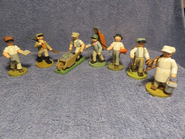 "This auction is for 7 Wendt and Kuhn Craftsmen. This is the complete 5311 set.  1)  Brickie with Rubbing Board and Trowel    3"" tall  2)  Construction Worker with Hoe                  3"" tall  3)  Construction Worker with Wheelbarrow   3"" tall  4)  Brick Carrier with Panier                           3 1/2"" tall  5)  Brickie with Brick and Trowel                    3"" tall  6)  Carpenter with Hacksaw and Plane          3"" tall  7)  Painter with Ladder                                   3"" tall"