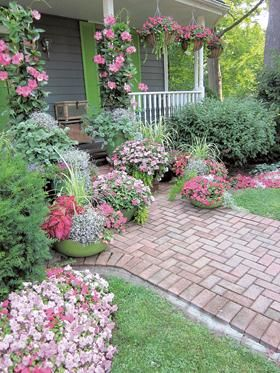 Planters with flower beds makes for lots of color!