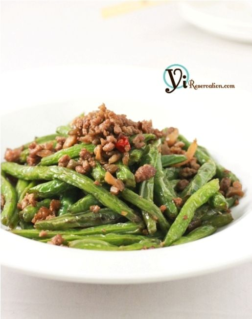 SZECHUAN - Traditionally, the string beans are first deep fried to seal the natural flavor. Then they are cooked using a special technique called dry-frying (乾煸) – a frying technique that involves high heat and little to no liquid. The technique is the key behind that famous slightly crispy outside but soft inside texture.