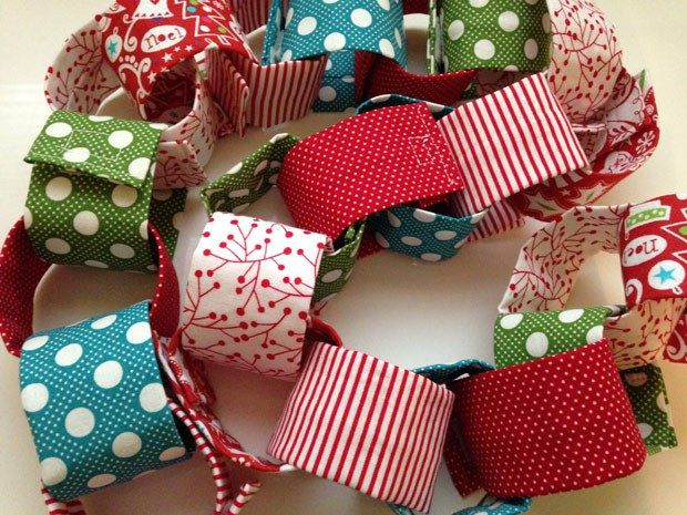 Fabric chain made with small scraps. Make a long garland strand to decorate the home or go shorter and craft a Christmas countdown chain.