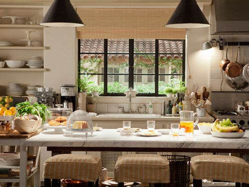 Love the eclectic feel. California kitchen. Monochrome dishware. White tiles. Stainless steel. Copper pots.