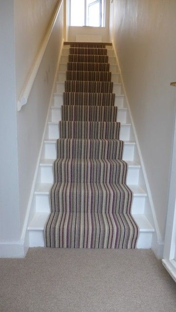 Neutral striped stair carpet runner with purple pinstripe. Stairs stripped and painted white.