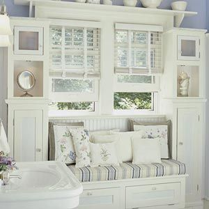 Lilac Lane Cottage: More Cottage Bathroom Inspiration--Ooh, ideas, ideas...there isn't room for a bench in the master bath but there is in thekids bath-maybe a smaller arrangement of this setup? Storage on both sides with a seat in the middle? Loveit!!! jb