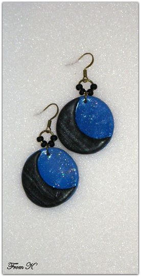 Crescent moon dangle earrings. Simple and delicate crescent moon dangle earrings handmade out of polymer clay, perfect for everyday wear! They are covered with special varnish gloss with glitter. About 3 cm in diameter. 4 cm with the ear piece. 10.00 Ron