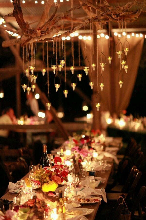 wedding lighting ideas with battery candles hanging down from decorative branches