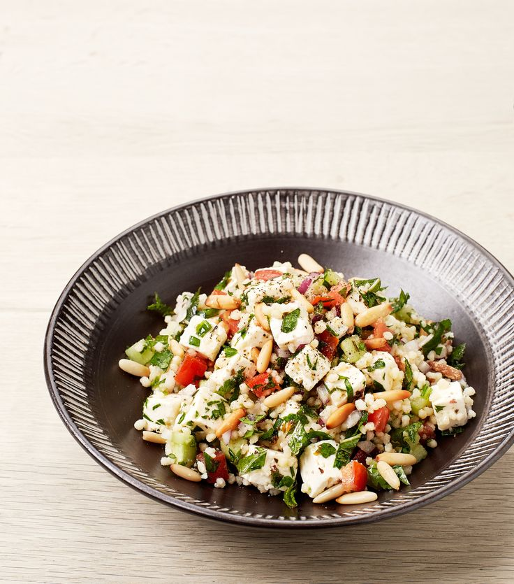 Classic tabouleh with feta cheese cubes and pine nuts