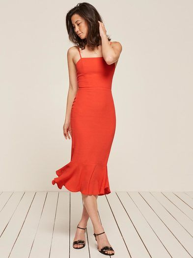 Fancy. This is a tight fitting, midi length dress with a straight neckline and a trumpet skirt.