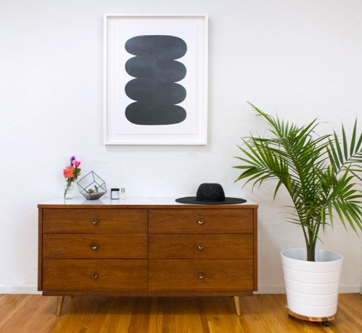Has: Good dresser, big plant in a great pot.  Needs: Different art, lamp, chair.