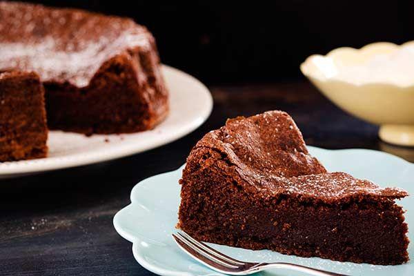 Chocolate almond cake | 200 gDark chocolate, chopped 180 gButter ¾ cupCaster sugar 2 tspVanilla extract 6Eggs, separated 1 TbspCocoa powder 1½ cupsGround almonds