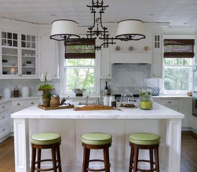 I love the pop of green on the stools in this bright kitchen!