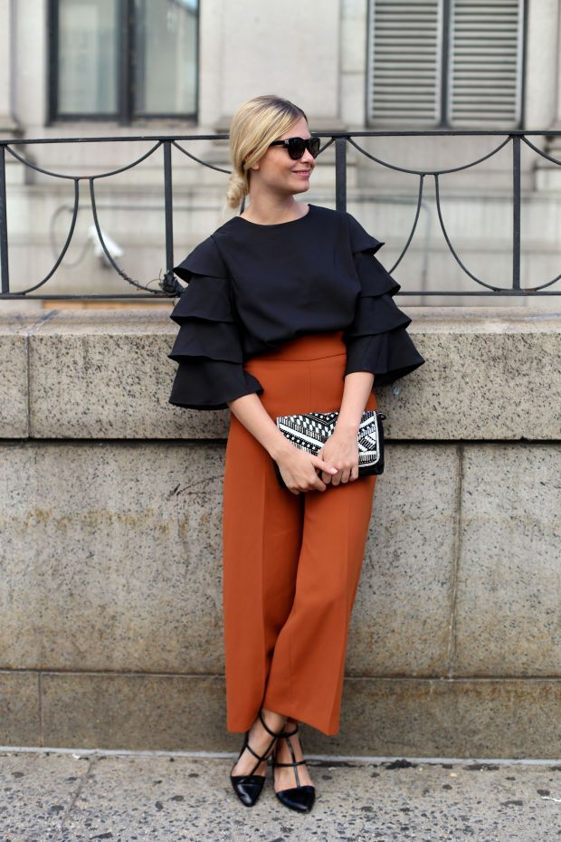 Burnt Orange Pantalones and black ruffle top