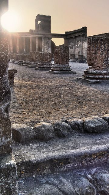 Roman ruins at sunset in Pompeii, Italy.