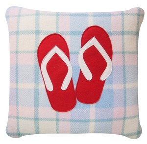 Baby blue tartan patterned cushion cover, with red & white jandals. In wool. 55NZD.