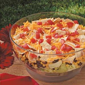 Speedy Southwest Salad Recipe -I used leftover corn and black beans I had in the fridge to throw together this simple layered salad. It's a big time-saver because it requires little chopping and features a quick dressing. The crunchy combination is always in demand at our house. -Kara Ann Goff, Loveland, Colorado