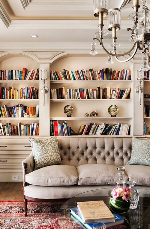 What a great reading room! built-in book shelves, snow globe decorations, persian rug and tufted couch (although honestly the couch doesn't look all that comfy).