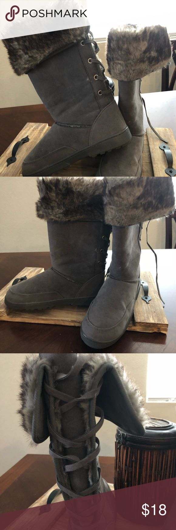 Faux fur lined boots Very nice fur-lined boots with laces in back . Shoes Winter & Rain Boots