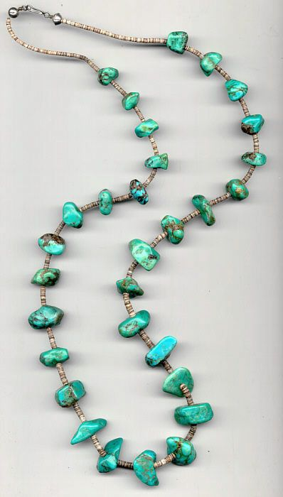 American Indian Turquoise jewelry,necklace,This Vintage Native American Jewelry Turquoise necklace was purchase thirty years ago. The 30 gorgeous large nuggets of turquoise with tiny shell spacers and silver hook form a 36 inch strand.   $750.00
