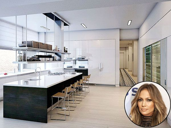 JENNIFER LOPEZ The singer and actress reportedly purchased a $22-million pre-war penthouse in Manhattan's Flatiron district. Her high-gloss kitchen is mostly white (rumored to be her favorite color) and accented with a mix of tasteful wood tones. During the warmer months, should J-Lo tire of that breakfast bar, she can always eat outside: Her sprawling digs also have a whopping 3,000 square feet of terrace space.