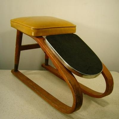 You always got fitted for shoes back then.  The shoe salesman sat on one of these.