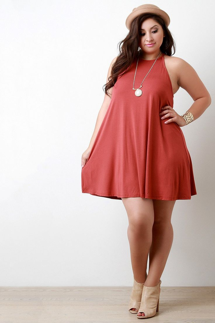 This plus size dress features a jersey knit fabrication, halter-designed…