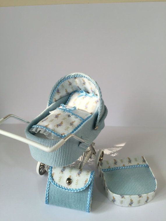 PLEASE ALLOW UP TO THREE WEEKS AT THE MOMENT AS THIS IS ONE OF MY BUSIEST TIMES Blue needlecord fabric ,miniature pram/stroller/buggy. With cute rabbit lining in blue and white, complete with quilt and pillow to match Wheels turn freely and the bag is removable All my miniatures are hand crafted by me to a high standard.  These items are collectible miniatures, not toys so are not suitable for children under 14  This item is available to ship immediately