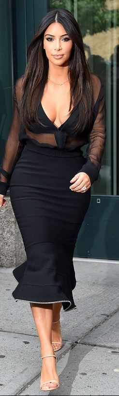 Kim Kardashian, black mesh top, mermaid flare skirt, and nude sandals