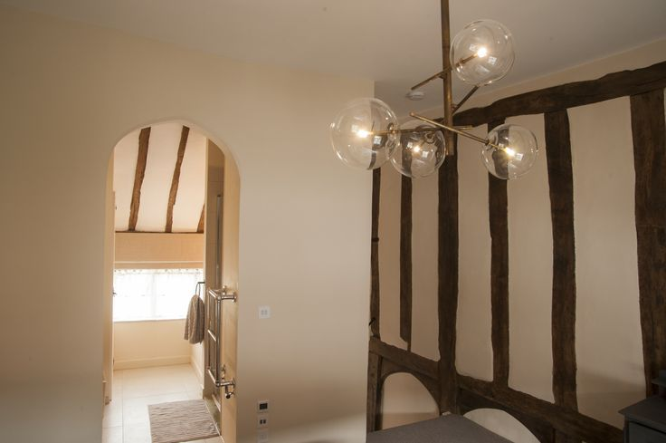 Medieval archway into the en suite. Boutique holiday cottage in Lavenham, Suffolk.