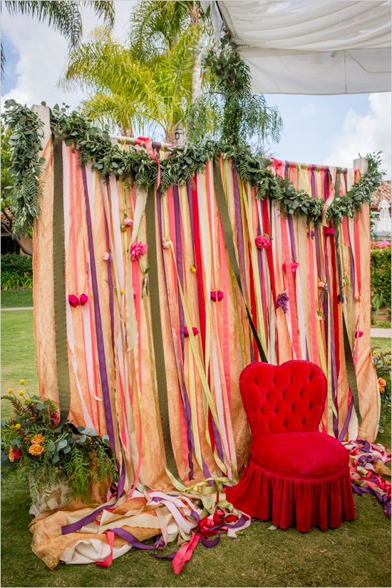ribbon draped ceremony backdrop changes into a photo booth with the addition of a plump cushy chair and props....so fun!