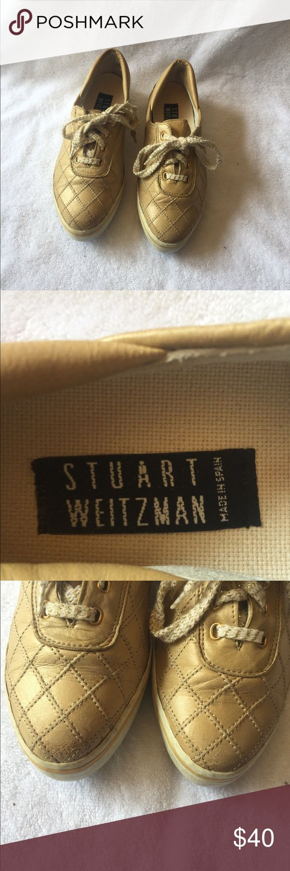 Stuart Weitzman sneakers size 6.5 gold Stuart Weitzmen gold sneakers with gold and white chevron pattern laces. Scuffs on toes. Stuart Weitzman Shoes Sneakers