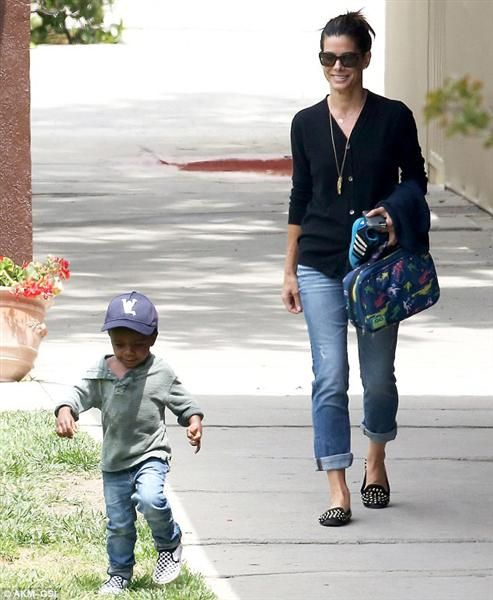 "Sandra Bullock, mom to son Louis Bardo ""Gravity"" star Sandra Bullock was still married to Jesse James when baby Louis Bardo was adopted. However, when that marriage went up in flames, Sandra took her baby son with her and never looked back. The happy family of two split their time between New York, New Orleans and Los Angeles. And we rarely see Sandra Bullock these days without her cute son in tow."