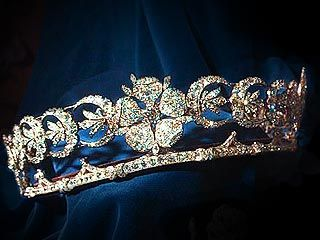 THE DUCHESS OF TECK  Not often seen in public since the 1940s, the tiara's rose centerpiece also features diamond-set ears of wheat and crescents fashioned in gold and silver.