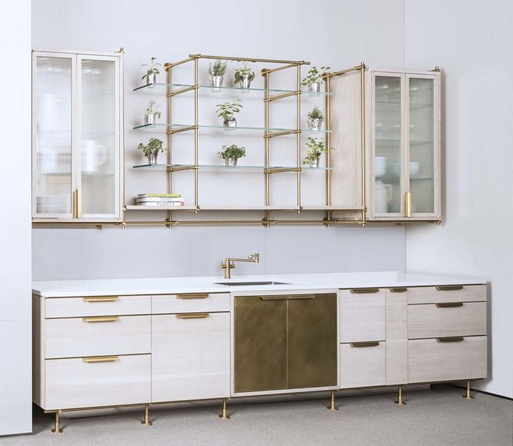 This kitchen is inspired from our Collector's Shelving System. Open brass shelves the kitchen seemed like a natural expansion. The glass shelves give this design a beautiful and elegant touch.