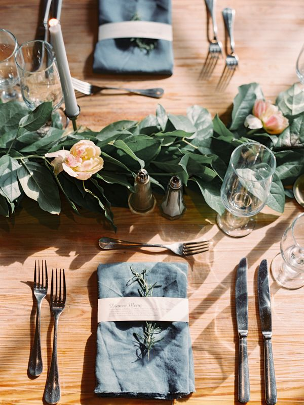 Simple greenery is just enough for these reception tables.