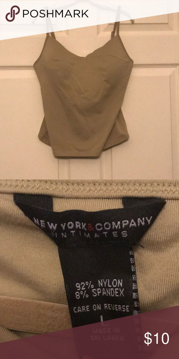 Beige camisole with shelf bra & padded cups Beige NY & Company camisole with shelf bra and built in padded cups. Worn only once no rips stains or tears. Non smoking home New York & Company Tops Camisoles