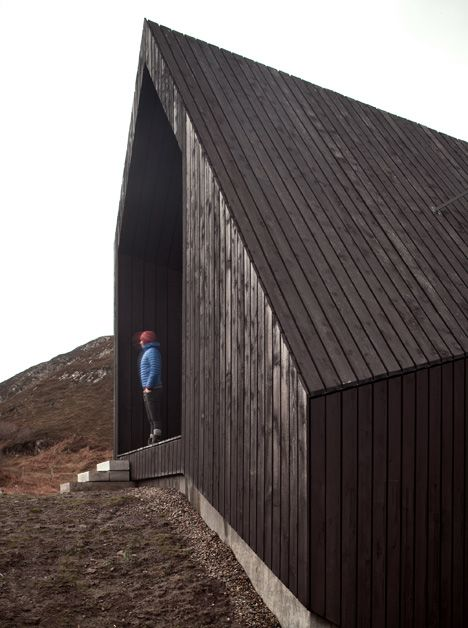 This house in the Scottish Highlands is partly buried into its sloping site and features a kinked plan that directs views towards the sunrise and sunset.