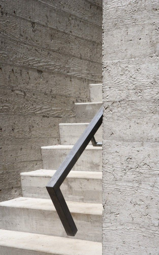 Concrete cast in rough sawn wooden formwork. The Bromont House by Paul Bernier Architect. Nice.