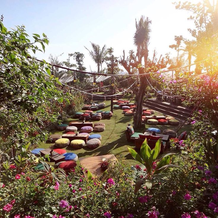 Colourful outdoor sitting area at popular Bali beach club 🌴. Bali, Indonesia.